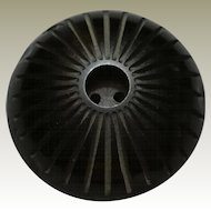 High Domed Black Bakelite Button with Radiating Spoke Carvings and Deep Carved Center Hole
