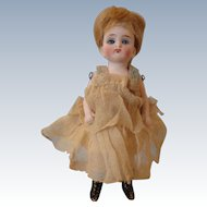 "SALE: Glass-eyed 4 1/2"" All Bisque Doll"