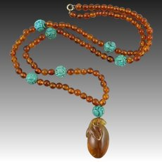 Carved Turquoise and Baltic Cognac Amber Asian Carved Pendant Necklace 27""