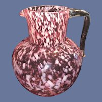 Late 1800s Phoenix Glass Cranberry Spatter Pitcher / Clear Handle
