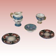 Beautiful Antique Dollhouse Porcelain and Limoges dishes.