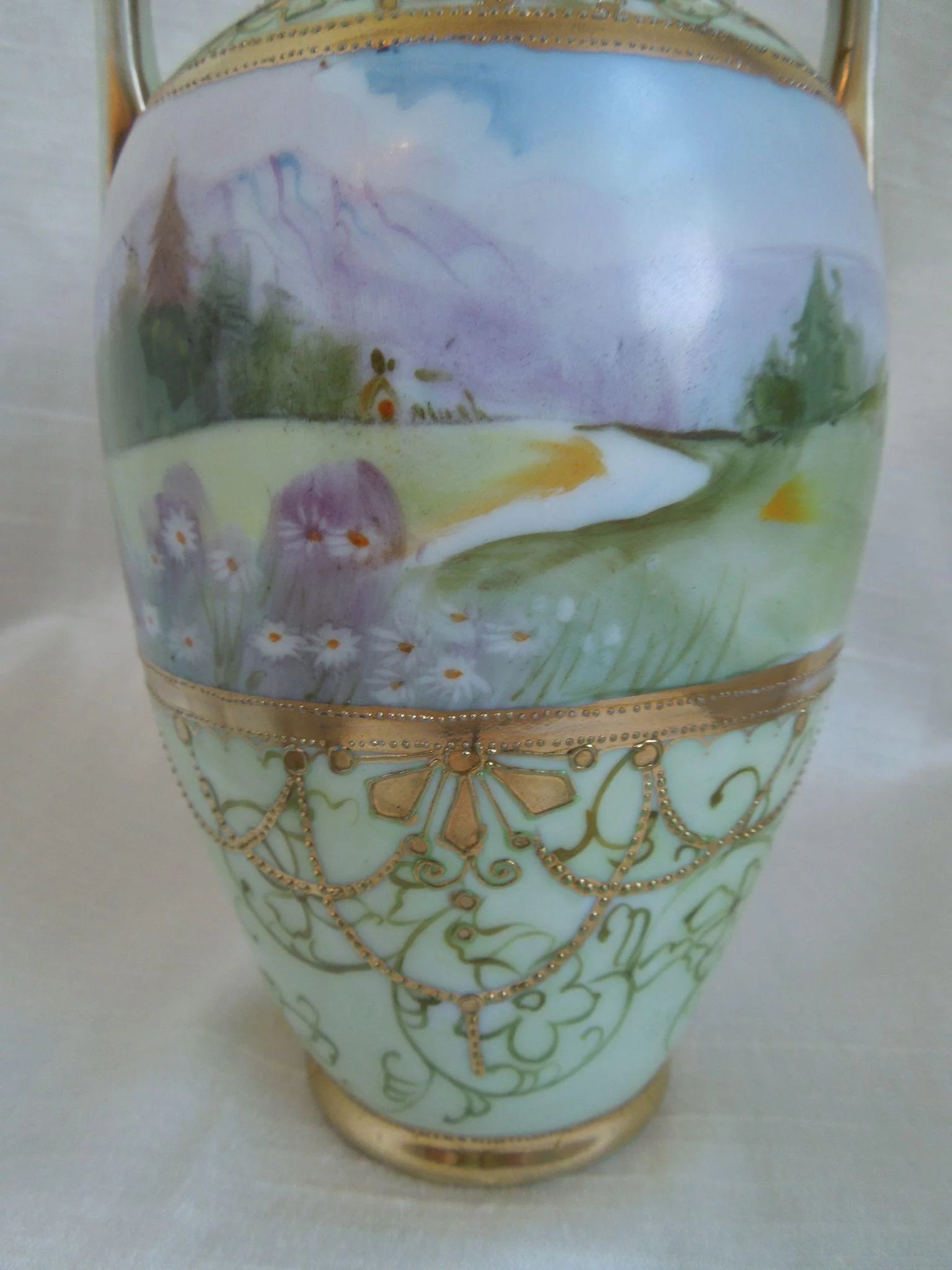 Nippon hand painted porcelain vase with landscape scene gilt work nippon hand painted porcelain vase with landscape scene gilt work click to expand reviewsmspy