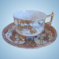 19th Century Antique Japanese Satsuma Hand Painted Porcelain Cup And Saucer, Footed, Raised Gold Gilt, Enamel, Artist Signed