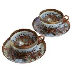 Antique Japanese Hand Painted Kutani Gilt Enamels Geishas Porcelain Pair Of Tea Cups And Saucers, Meiji, Japan, Artist SIgned