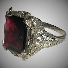 Art Deco 14 Karat White Gold Filigree Faceted Deep Red Garnet Ring Early 1900s