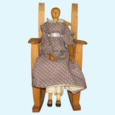 Folk Art Carved Wooden Doll and Rocking Chair