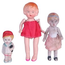 Three Vintage Small Dolls