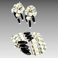 Dazzling Hobe Spring coil bracelet and Long Cha Cha Earrings