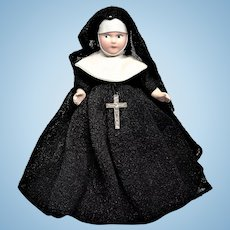 Hard Plastic Nun with beautifully painted face.