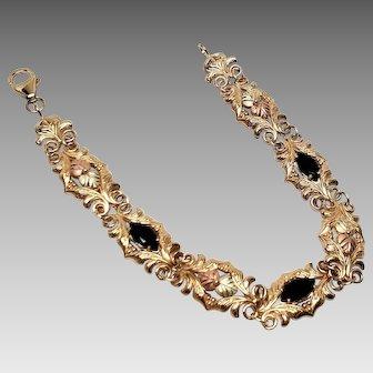 "10K Black Hill Leaf Two Tone Swirl Bracelet with Onyx 7"" Yellow Gold"