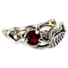 A Ruby Sterling Silver 14k Gold Ring