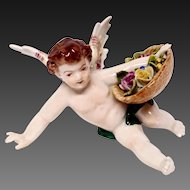 Charming Volkstedt Reclining Putto With Flowers Basket Figurine
