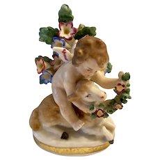 Delightful Sitzendorf Cherub Or Putto with Sheep & Flower Garland