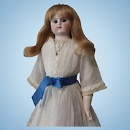 ABG (Alt,  Beck, Gottschalck) doll;  leather body with bisque lower arms; bisque dome head; blonde wig; brown eyes; 21.5 inches