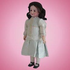 Antique SFBJ 301 doll-21.5 inches tall/black human hair wig/brown sleep eyes - nice silk dress