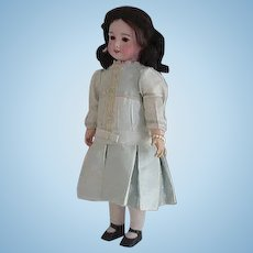 Antique SFBJ 301 doll-21.5 inches tall/black human hair wig/brown sleep eyes - nice silk dress