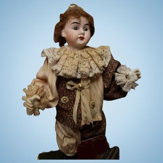 French Mechanical doll with extra doll head on base.   Music box works.