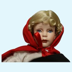 Red Riding Hood porcelain doll - approximately 12 inches in height
