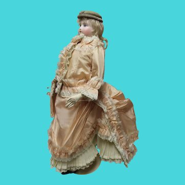 FRENCH FASHION doll in silk garment-Stands 18.5 inches tall on leather body/open dome head with original cork pate/painted eyes