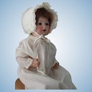 """Armand Marsaille baby doll 975-approximately 18 inches with sleep eyes and 14"""" diam. head"""