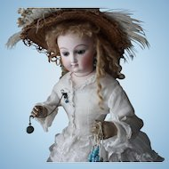 """Bru- French doll """"J""""/22 Inch/wooden jointed arms & hands/excellent leather body/fine white dress and undergarments/straw hat/parasol/white button shoes"""