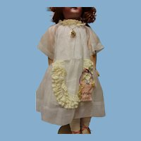 Doll dress, homemade, cute and 15 inches in length.
