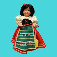 Italian, hard plastic doll, stands 13 inches in original costume