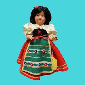 Italian, hard plastic doll, stands 13 inches in original costume