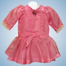 Handmade doll dress -  pink dress with attached underlining.  Measure 4 inches at shoulder and 11.5 inches in length-vintage fabric