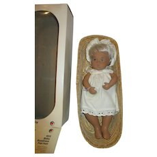 Blonde Sasha Baby doll in wicker basket with original box and hang tag on wrist