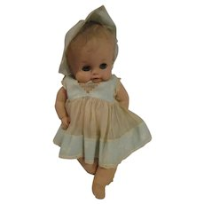 "Absolutely adorable Sun Rubber baby doll  13"" original era clothing"