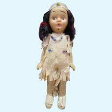"""Small unusual frozen charlotte all bisque Native American doll in paper outfit with beads old 5"""""""