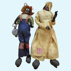 Vintage Black Americana couple Ma with her pipe and Pa with his ball and chain folk art dolls