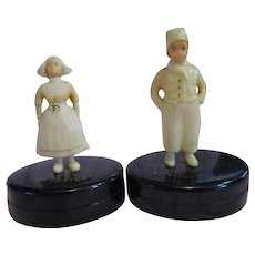"Celluloid Sewing pin cases vintage Dutch boy and girl, top opens small 3"" Canada"