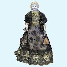 "Elaborate Germany China head doll 13"" leather body"