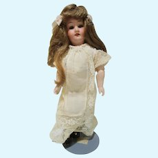 "Armand Marseille German bisque head doll wood body 9"" tall lovely"