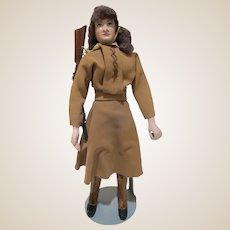 "Vintage composition 10"" Annie Oakley doll with gun"