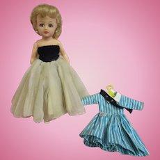 Vintage Little Miss Revlon doll in velvet topped gown with original school girl tagged dress