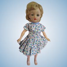 Pretty Little Miss Revlon Ideal doll blonde in floral dress with waist sash scarf