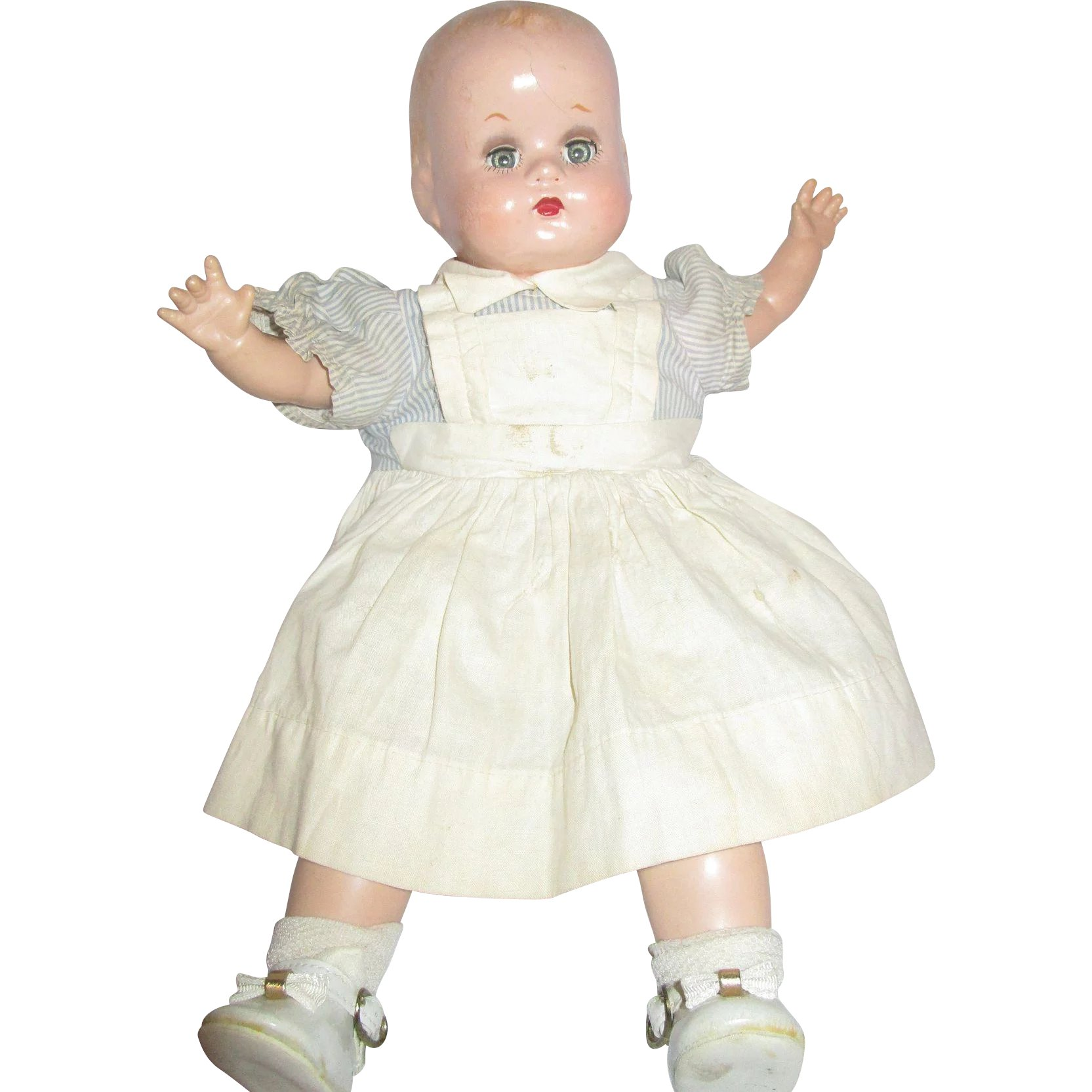 "15"" position and Cloth baby doll possibly marked APX sleep eyes"