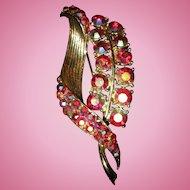 Vintage Unmarked Red Aurora Borealis rhinestone and gold-toned metal brooch pin retro era