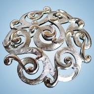 Crown Trifari vintage brooch pin with swirling silver colored design gorgeous