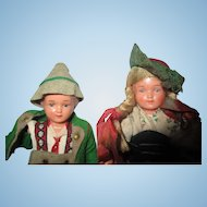 Very old German pair of dollhouse dolls in original outfits Need TLC