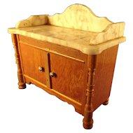 Golden Oak Cabinet With Marble Top and Backsplash