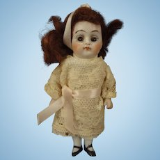 "All Bisque 4 1/2"" Doll with Sleep Eyes and Jointed Limbs"