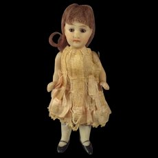 """4"""" All Bisque Doll with Glass Eyes and Jointed Limbs"""