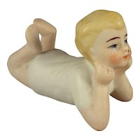 All Bisque Reclining Boy with his Head in his Hands