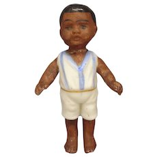 "2 1/2"" All Bisque Boy in Molded Clothes"