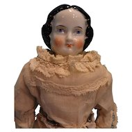 "11"" Black Hair China Doll with Orange Boots"