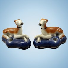 Pair of  Seated Porcelain Whippets